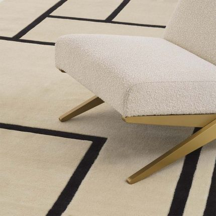 Off-white and black geometric patterned rug made from New Zealand wool.