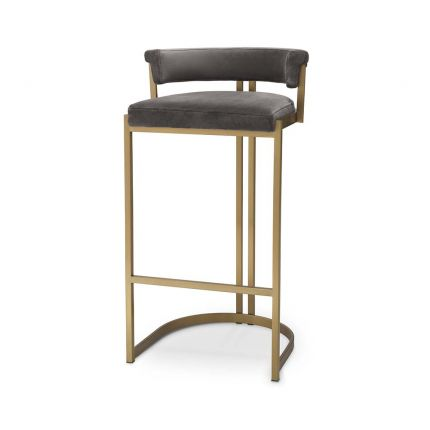 Art Deco inspired bar stool with a brushed brass frame and a grey velvet seat.