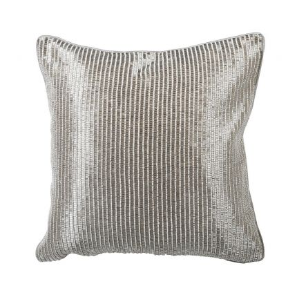 A stylish cushion with hand-embroidered sequin detailing