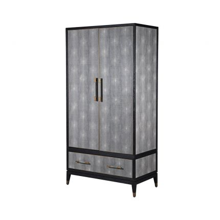 A stunning grey shagreen wardrobe with black and gold accents