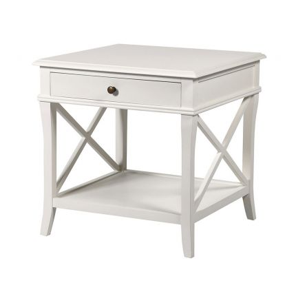 A luxurious, classic white bedside table with a drawer