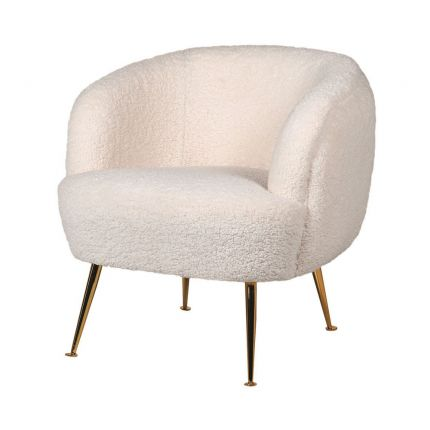 A luxurious contemporary armchair with faux shearling upholstery and golden, tapered legs