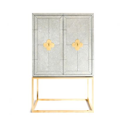An elegant antiqued glass and polished brass maximalist bar