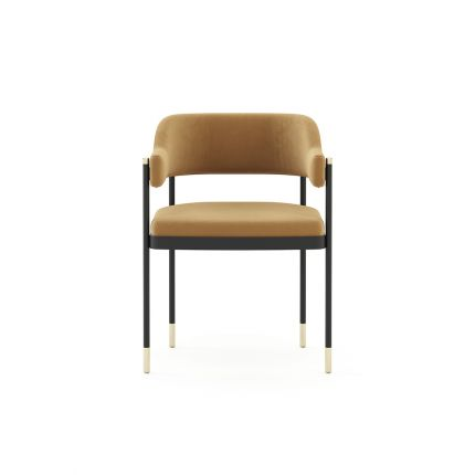 A luxurious dining chair with a minimal frame and velvet upholstery. Pictured in Vienna Camel.