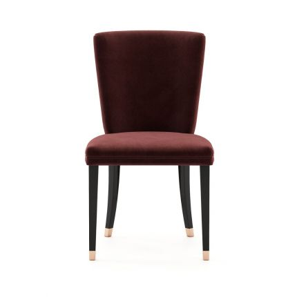A luxurious wine coloured velvet chair with dark legs and golden caps. Pictured in Vienna Wine.