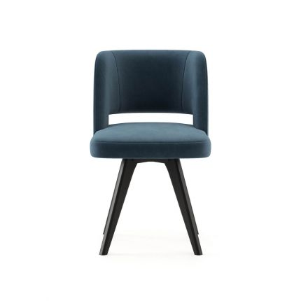 A glamorous Mid-Century dining chair with velvet upholstery and dark legs. Pictured in Vienna Ocean.
