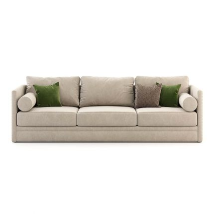 Luxurious sofa with velvet upholstery and golden studding. Pictured in Vienna Beige.
