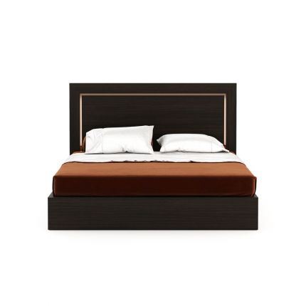 A luxurious eucalyptus wood bed with metallic accents