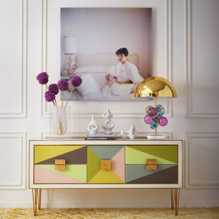 A polished brass table lamp with multicoloured acrylic globes and a marble base