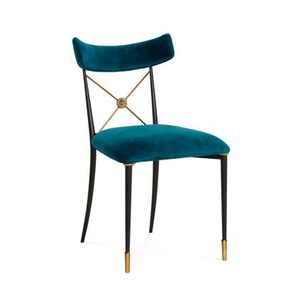 A luxurious vintage-style dining chair with polished brass accents and navy upholstery
