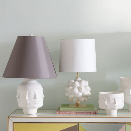 A porcelain faced table lamp with a grey shade and nickel accents