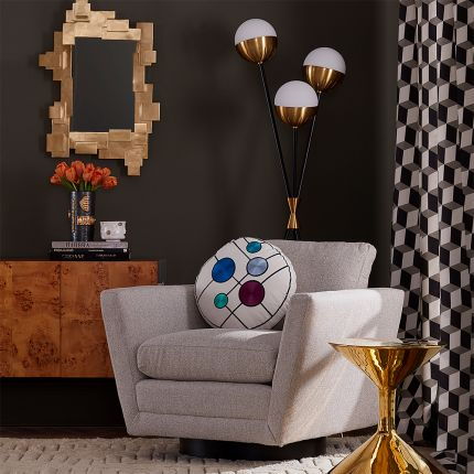 A stylish, geometric accent wall mirror in an antique brass finish