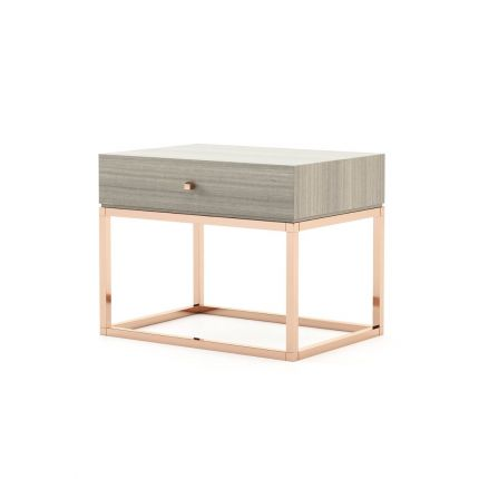 A modern grey bedside table with a copper base and details