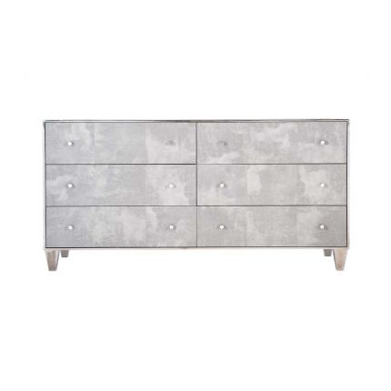 A luxurious, faux vellum chest of drawers with six drawers
