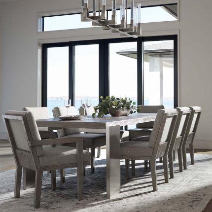 French-inspired dining table with steel legs and wooden top.
