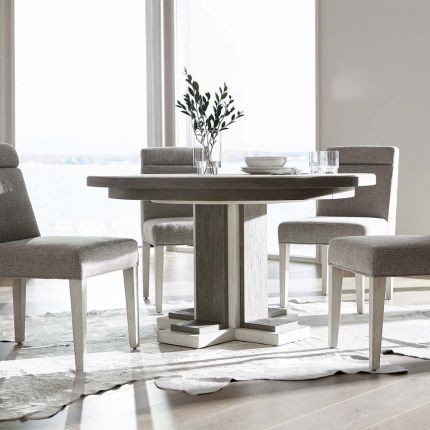 Circular dining table with two toned wood
