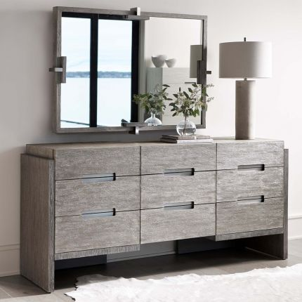 A gorgeous grey, two toned dresser from Bernhardt with nine soft closing drawers and stainless steel hardware