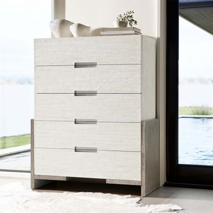 A luxurious tall drawer chest from Bernhardt with a lovely two tone finish, brushed stainless steel handles and five soft closing drawers