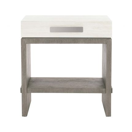 A gorgeous bedside table from Bernhardt featuring a two tone finish, soft closing drawer box, base shelf and dual port