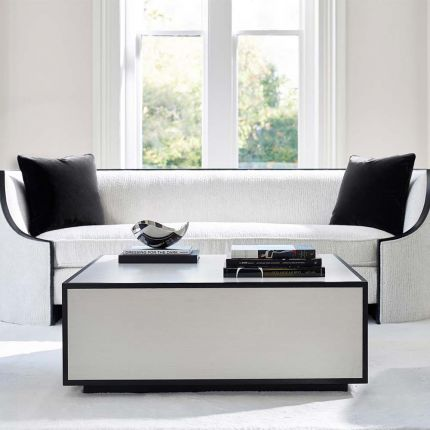 A contemporary coffee table with a graphic, black outline.