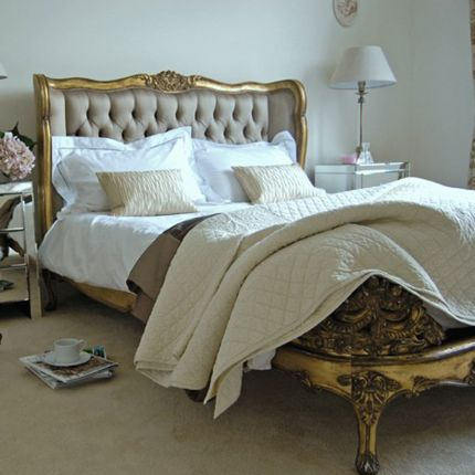 Gold gilt french bed with deep buttoned deep gold headboard