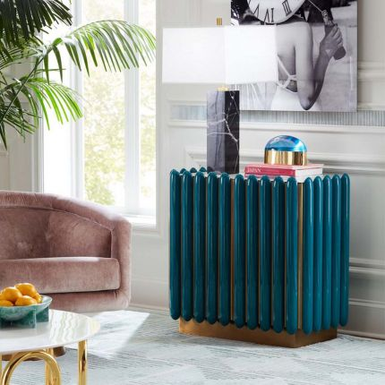 A retro-futuristic inspired cabinet in a teal finish and brass base.