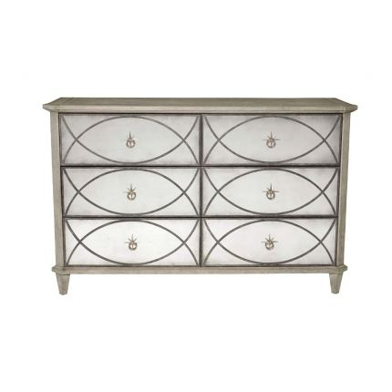 A chest of drawers with antique mirror panels on each drawer.