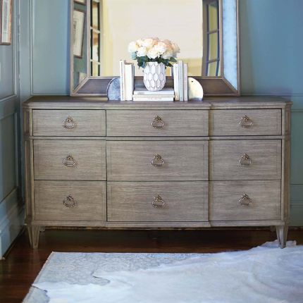 A nine drawer dresser with various drawer sizing - perfect for any rustic or contemporary decor