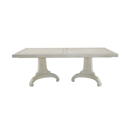 A provincial inspired dining table with extendable leaf