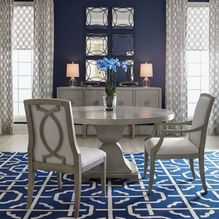 Circular dining table in a two toned wood