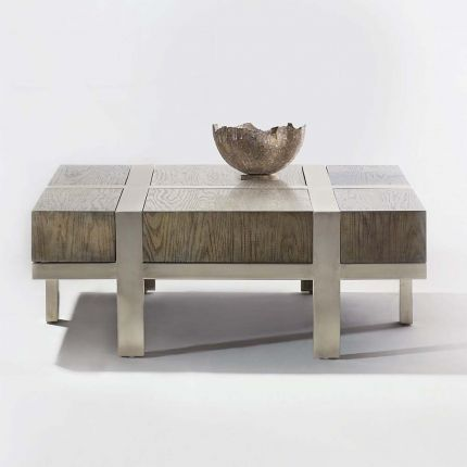 An industrial and scandinavian inspired coffee table with steel panel details.