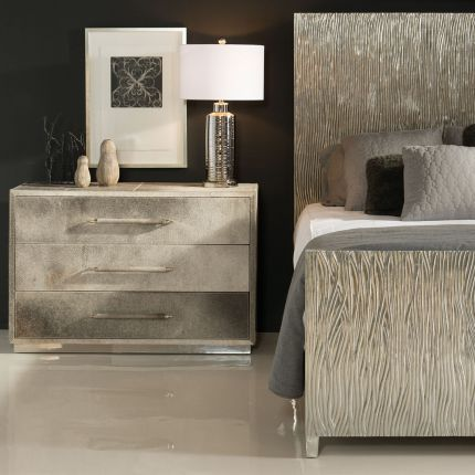 A unique and natural three drawer chest of drawers with a white interior and polished stainless steel plinth base