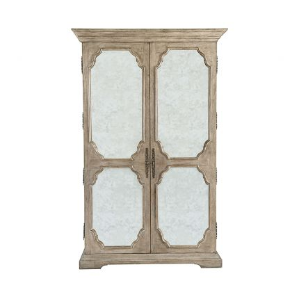 A beautiful armoire by Bernhardt featuring two wood-framed doors with antique mirrored glass panels