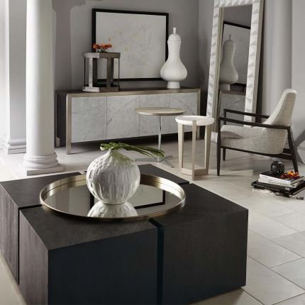 An abstract coffee table with a mirrored top