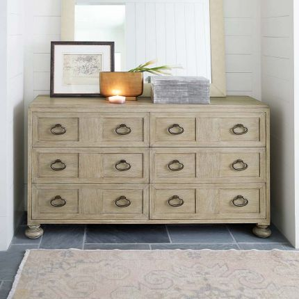 A six drawer dresser with subtle carvings within the front panels.