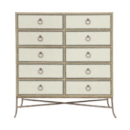 A ten drawer tallboy with upholstered drawer panels in a performance fabric and a sand finish