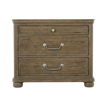 A peppercorn finished bedside table with 3 drawers