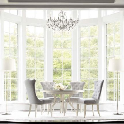 pale, circular dining table