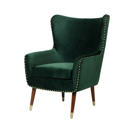 A luxurious green velvet armchair with brass studs and brown legs with brass caps