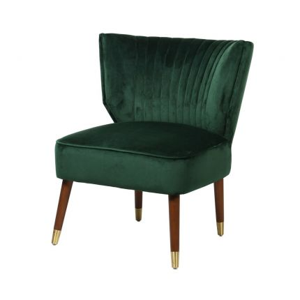 Green velvet armchair with brown legs and brass caps