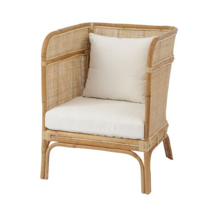 A natural rattan and cane chair with a rounded back and cushioned seat