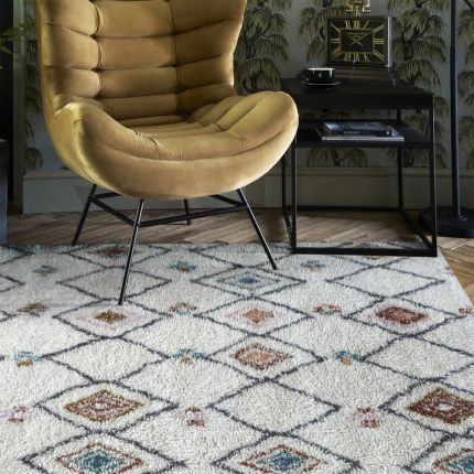 Multi-coloured patterned table tufted wool rug
