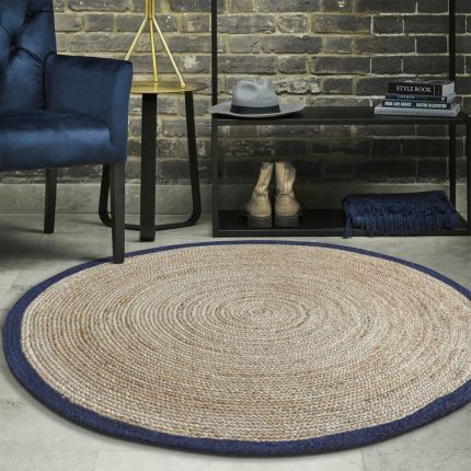A luxurious handwoven hemp rug with a navy rim and pit loom finish