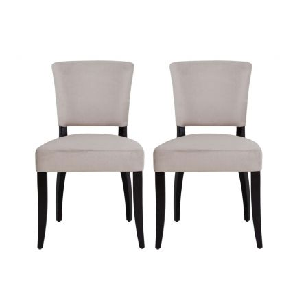 A set of two neutral dining chairs with wooden legs and studding