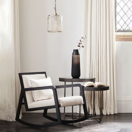 Contemporary modern wooden rocking chair with neutral seat cushions