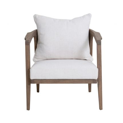 A luxurious mindi wood chair with off-white upholstery and a rattan backrest