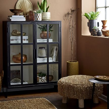 A chic, industrial-style display cabinet with a black oak and metal finish