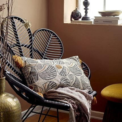 A gorgeous yellow and black patterned rectangular cushions with yellow fringing