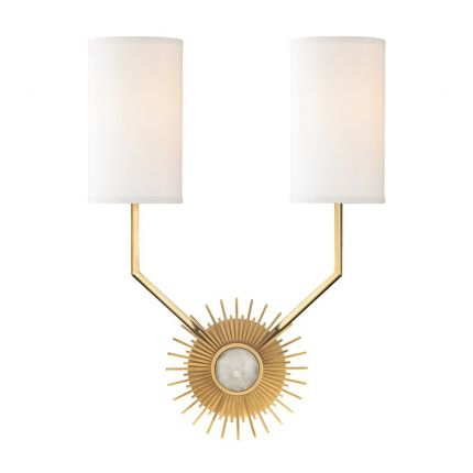 A glamorous sunburst wall sconce with dual silk lamps
