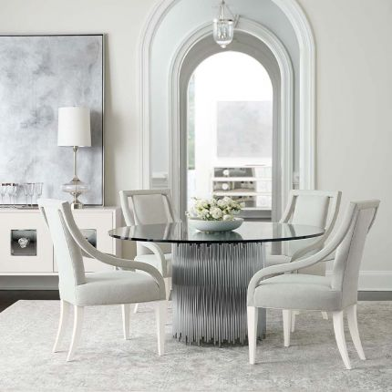 circular dining table with glass top and pipe details